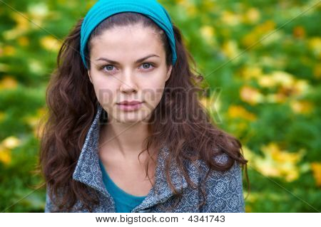 Beautiful Young Woman In A Autumn Park
