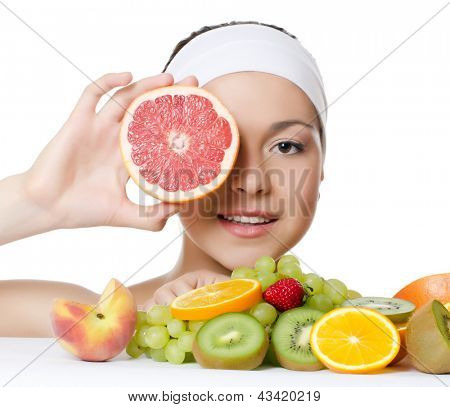 The beautiful woman with a fruit isolated