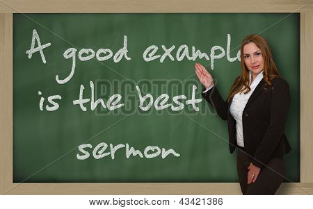 Teacher Showing A Good Example Is The Best Sermon On Blackboard
