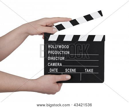 Hands holding a film clapperboard with clipping path