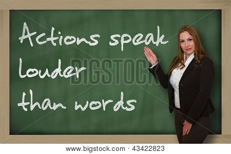 Teacher Showing Actions Speak Louder Than Words On Blackboard