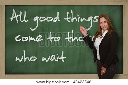 Teacher Showing All Good Things Come To Those Who Wait On Blackboard