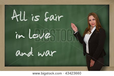 Teacher Showing All Is Fair In Love And War On Blackboard
