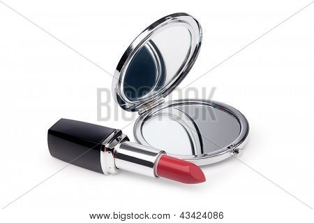 Red lipstick and mirror on white background