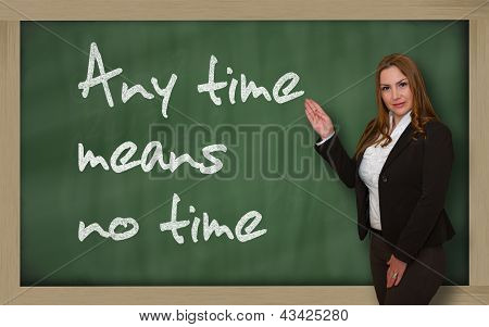 Teacher Showing Any Time Means No Time On Blackboard