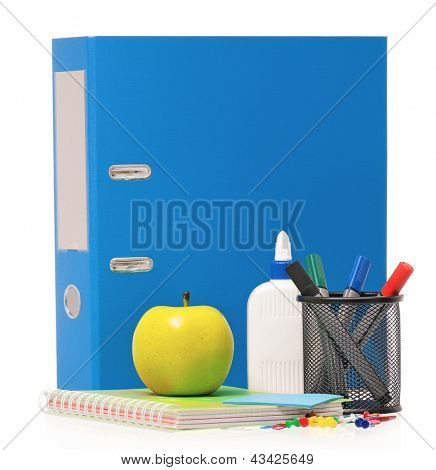 Big blue folder, markers, exercise book and green apple isolated on white background