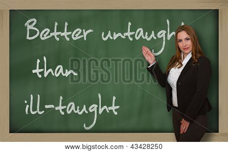 Teacher Showing Better Untaught Than Ill-taught On Blackboard