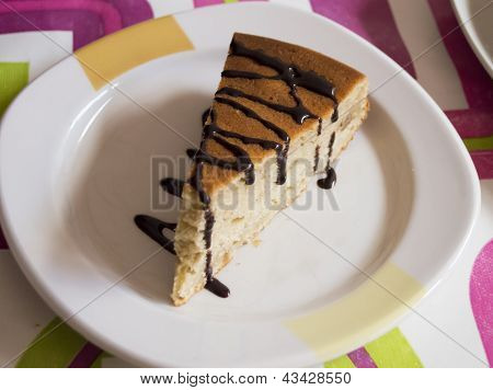 a portion of cake with dark chocolate