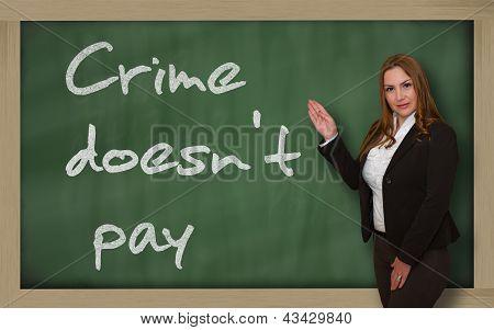 Teacher Showing Crime Doesn't Pay On Blackboard