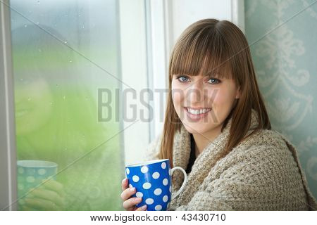 Portrait Of A Beautiful Woman Smiling With Cup Of Tea