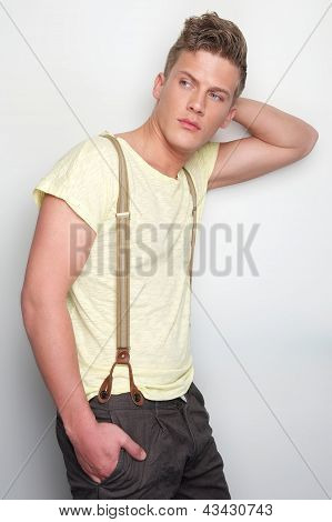 Handsome Young Man Leaning Against Wall