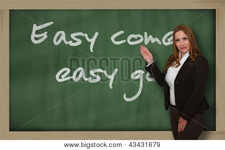 Teacher Showing Easy Come, Easy Go On Blackboard