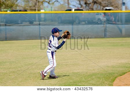 Youth Shortstop About To Throw Ball