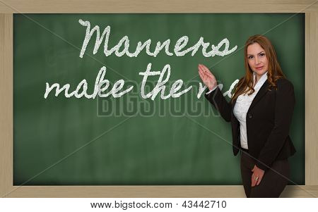 Teacher Showing Manners Make The Man On Blackboard
