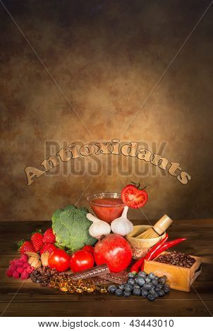 Antioxidants fruits and vegetables on a wooden table with text