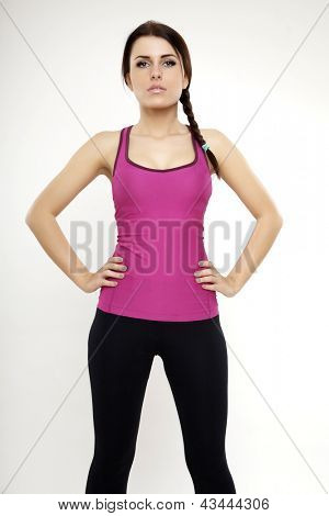 Young attractive brunette sporty woman in violet dress isolated on white background standing and looking on camera
