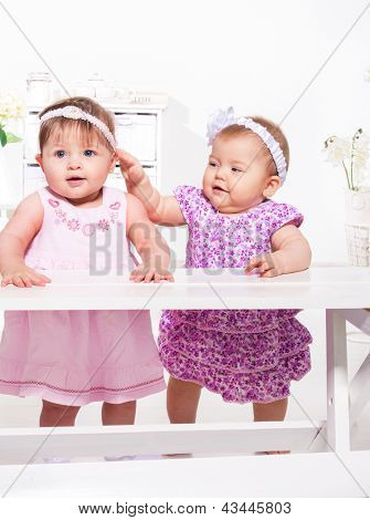 Beautiful baby girls playing