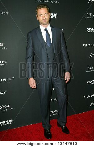LOS ANGELES - MARCH 18: Gerard Butler arrives at the premiere of
