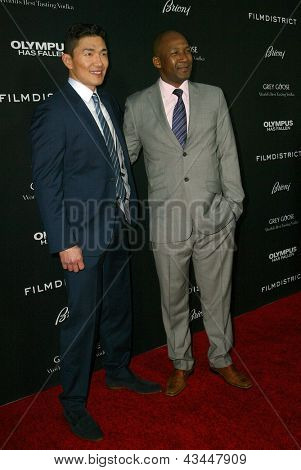 LOS ANGELES - MARCH 18: Rick Yune and Duma Boka arrive at the premiere of