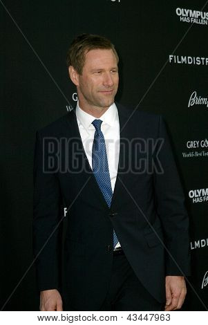 "LOS ANGELES - MARCH 18: Aaron Eckhart arrives at the premiere of ""Olympus Has Fallen"" at the ArcLight Hollywood Theatre in Los Angeles, CA on March 18, 2013."