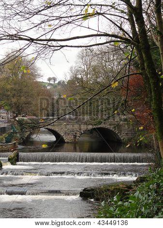River Waterfall With Bridge