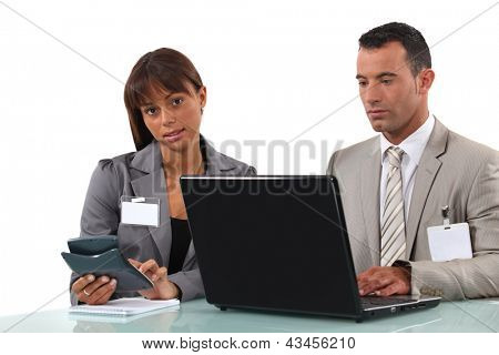 Business couple  with a laptop and calculator