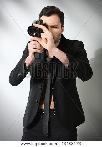 Attractive man taking photo