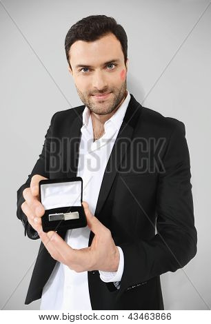 Attractive man holding black box with cufflinks