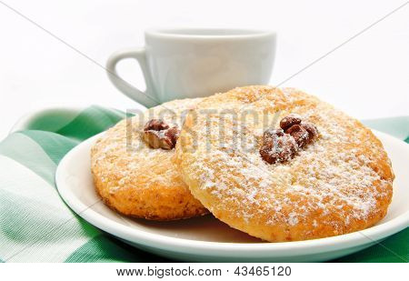 Delicious Cookies On A Plate And Cup Of Tea Isolated
