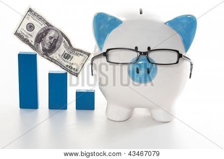 Blue and white piggy bank wearing glasses with blue graph model on white background