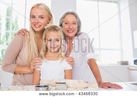 Cheerful mothers and daughters cooking together in the kitchen