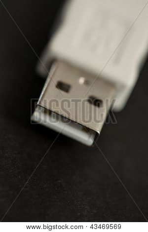 Close up of white tip of cable USB