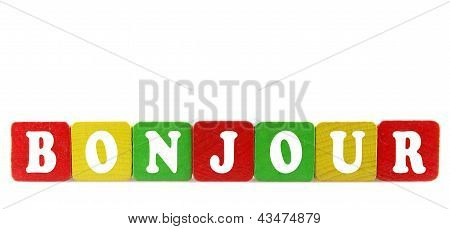 Bonjour - Isolated Text In Wooden Building Blocks
