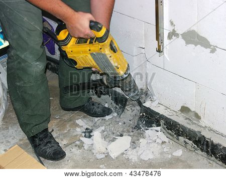 Jackhammer in the worker hands