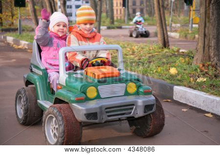 Children In Toy Car