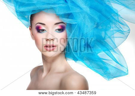 portrait of beautiful girl with a hat from a blue veil