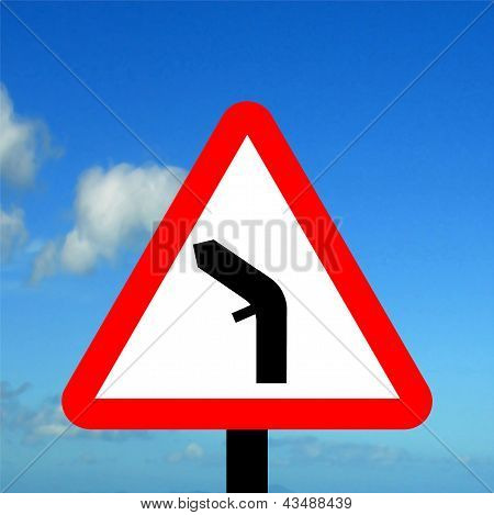 Warning triangle junction on a bend traffic sign