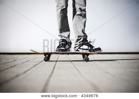 Skater Standing On His Skateboard