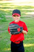 stock photo of little-league  - Portrait of a little league baseball player in red and black jersey - JPG