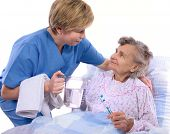 stock photo of crippled  - Nurse helps the senior woman in washing - JPG
