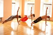 pic of concentration man  - Group of men and women practicing yoga in health club - JPG