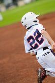 foto of little-league  - Little league baseball player running to first base - JPG