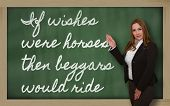 Teacher Showing If Wishes Were Horses, Then Beggars Would Ride On Blackboard