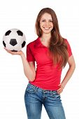 stock photo of debonair  - Athletic girl in jeans with soccer Ball - JPG