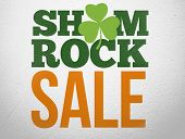 Advertisement for shamrock sale with shamrock on wall style background