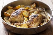roast chicken legs,cooked with rosemary, lemon and potatoes