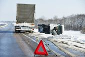 image of slippery-roads  - Lorry trailer car crash smash accident on an slippery winter snow interstate road - JPG