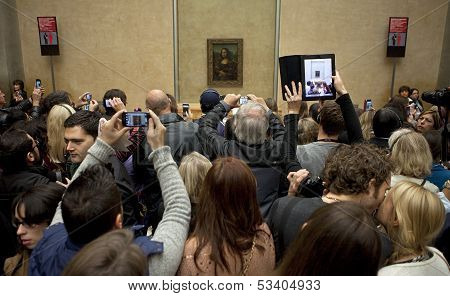 Visitors At The Louvre Looking At The Mona Lisa