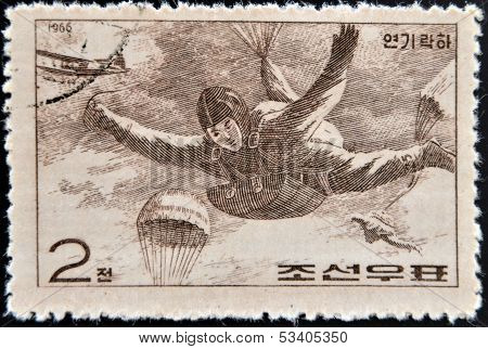 CHINA - CIRCA 1966: A stamp printed in China shows paratrooper in fall circa 1966