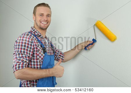 Portrait of young foreman on grey background
